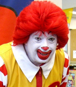 You know how much I hate clowns. Just looking at this freak is disturbing me immensely.  His hair is tamer than mine though.